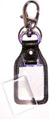 Chaveiro 3x4 com lente resinada em metal com couro